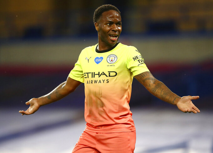 Manchester City's Raheem Sterling gestures during the English Premier League soccer match between Chelsea and Manchester City at Stamford Bridge, in London, England, Thursday, June 25, 2020. (AP Photo/Julian Finney,Pool)