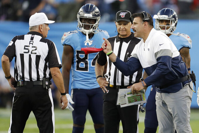 Tennessee Titans head coach Mike Vrabel, right argues about the placement of the ball late in the fourth quarter of an NFL football game against the Los Angeles Chargers Sunday, Oct. 20, 2019, in Nashville, Tenn. (AP Photo/James Kenney)