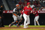 Los Angeles Angels' Shohei Ohtani (17) strikes out during the sixth inning of a baseball game against the Houston Astros, Monday, Sept. 20, 2021, in Anaheim, Calif. (AP Photo/Marcio Jose Sanchez)
