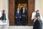 Greek President Prokopis Pavlopoulos, left, welcomes German President Frank-Walter Steinmeier at the Presidential Palace in Athens, Thursday, Oct. 11, 2018. Steinmeier is in Greece on a two-day official visit. (Michalis Karagiannis/Pool Photo via AP)