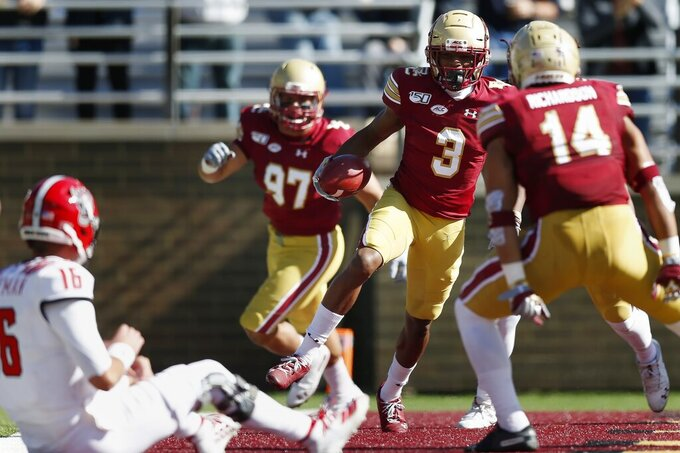 North Carolina State quarterback Bailey Hockman (16) watches as Boston College defensive back Jason Maitre (3) celebrates his interception and touchdown during the first half of an NCAA college football game in Boston, Saturday, Oct. 19, 2019. (AP Photo/Michael Dwyer)