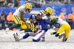 New York Giants quarterback Daniel Jones, center, is sacked by Green Bay Packers defenders during the second half of an NFL football game, Sunday, Dec. 1, 2019, in East Rutherford, N.J. (AP Photo/Adam Hunger)
