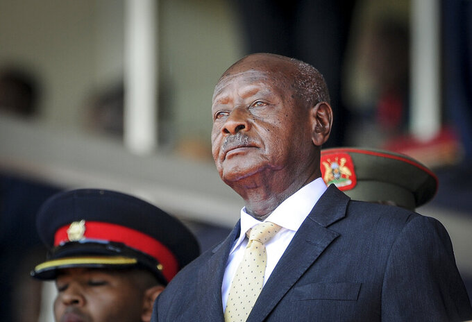 FILE - In this Feb. 11, 2020 file photo, Uganda's President Yoweri Museveni attends the state funeral of Kenya's former president Daniel Arap Moi in Nairobi, Kenya. Authorities in Uganda have suspended Friday, Aug. 20, 2021 the work of more than 50 civic groups, ranging from rights watchdogs to women's groups, over alleged non-compliance with regulations, dealing a blow to hundreds of thousands of people who directly benefit from the activities of such groups. (AP Photo/John Muchucha, File)