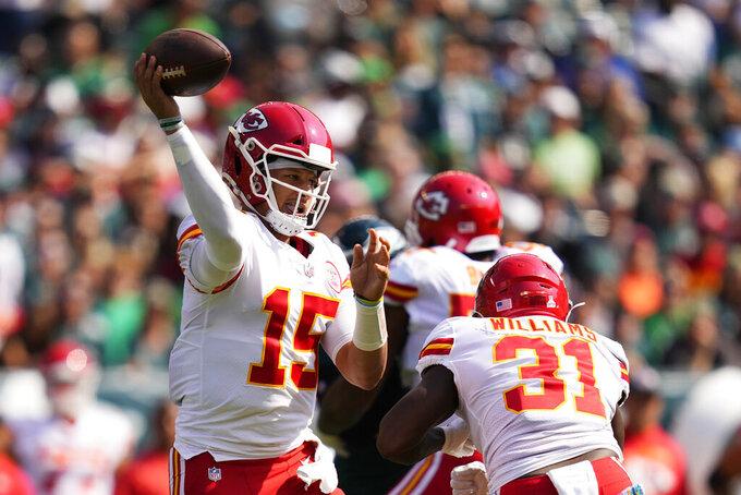Kansas City Chiefs quarterback Patrick Mahomes (15) looks to pass during the first half of an NFL football game against the Philadelphia Eagles on Sunday, Oct. 3, 2021, in Philadelphia. (AP Photo/Matt Slocum)