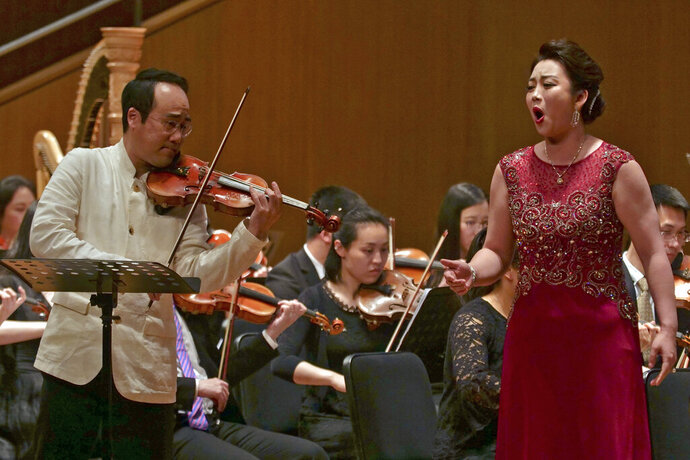South Korean violinist Won Hyung Joon and his North Korean soprano partner Kim Song Mi perform at the Shanghai Oriental Arts Center in Shanghai on Sunday, May 12, 2019. Won, a South Korean, performed together with Kim, a North Korean, in a rare joint performance they hope would help bring the divided Koreas closer together via music. Their performance comes three days after North Korea fired two suspected short-range missiles in the second such weapons test in five days. (AP Photo/Dake Kang)