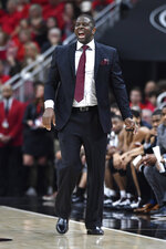 North Carolina Central head coach LeVelle Moton shouts instructions to his team during the first half of an NCAA college basketball game against Louisville in Louisville, Ky., Sunday, Nov. 17, 2019. (AP Photo/Timothy D. Easley)