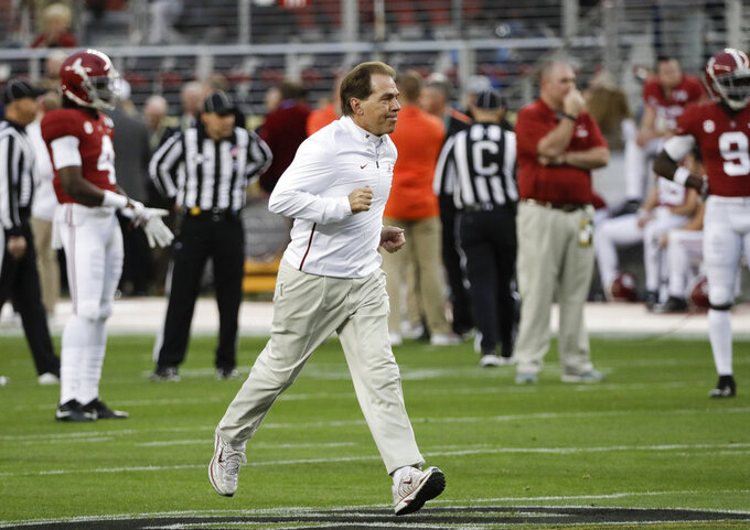 Alabama head coach Nick Saban runs across the field during warm ups before the NCAA college football playoff championship game against Clemson Monday, Jan. 7, 2019, in Santa Clara, Calif. (AP Photo/David J. Phillip)