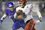 Fresno State quarterback Marcus McMaryion (6) runs past Boise State linebacker Sam Whitney (53) during an NCAA college football game for the Mountain West Conference championship Saturday, Dec. 1, 2018, in Boise, Idaho. (Drew Nash/The Times-News via AP)