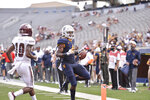 West Virginia running back Leddie Brown (4) rushes in for a touchdown against Eastern Kentucky during an NCAA college football game on Saturday, Sept. 12, 2020, in Morgantown, W.Va. (William Wotring/The Dominion-Post via AP)