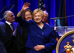FILE - In this Wednesday, Jan. 2, 2019 file photo, Gov. Janet Mills acknowledges applause after taking the oath of office at the Augusta Civic Center in Augusta, Maine. Soon after taking office, Mills announced renovation plans for the governor's mansion. She wanted to add solar panels. (AP Photo/Robert F. Bukaty)