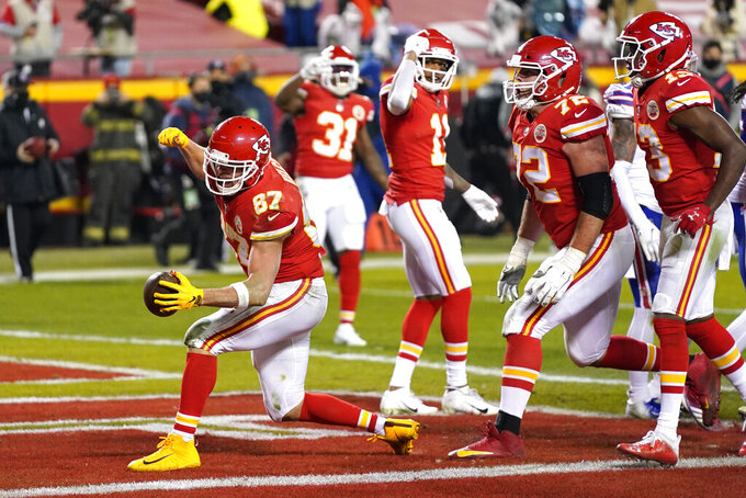 Kansas City Chiefs tight end Travis Kelce (87) celebrates after catching a 1-yard touchdown pass during the second half of the AFC championship NFL football game against the Buffalo Bills, Sunday, Jan. 24, 2021, in Kansas City, Mo. (AP Photo/Jeff Roberson)
