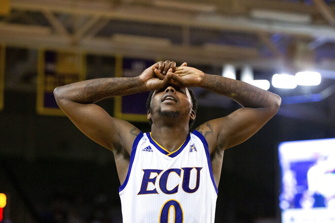 East Carolina's Isaac Fleming (0) reacts to a call during the second half of an NCAA college basketball game against Houston in Greenville, N.C., Wednesday, Feb. 27, 2019. (AP Photo/Ben McKeown)