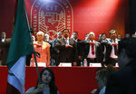 Miners' Union leader Napoleon Gomez Urrutia, center, who is also serves as a senator, salutes during the playing of the Mexican national anthem at the inauguration ceremony for his new International Labor Confederation (CIT) in Mexico City, Wednesday, Feb. 13, 2019. Urrutia says that 150 unions have joined the CIT and that other unions have expressed interest in joining, the latest sign that Mexico's long-dormant labor movement is awakening, and one month after massive walkouts began at border assembly plants in Matamoros. (AP Photo/Marco Ugarte)