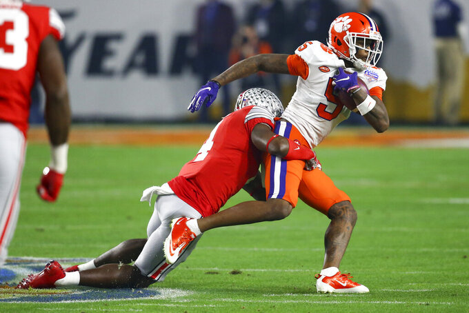 Clemson wide receiver Tee Higgins, right, is tackled by Ohio State safety Jordan Fuller during the first half of the Fiesta Bowl NCAA college football playoff semifinal Saturday, Dec. 28, 2019, in Glendale, Ariz. (AP Photo/Ross D. Franklin)
