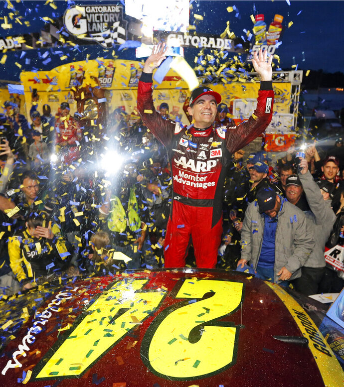 FILE - In this Nov. 1, 2015, file photo, Jeff Gordon celebrates in Victory Lane after winning the NASCAR Sprint Cup Series auto race at Martinsville Speedway in Martinsville, Va. Gordon headlines the 10th class of the NASCAR Hall of Fame for his storied career on and off the track. He'll be inducted on Friday night, Feb. 1,2019, along with NASCAR team owners Roger Penske and Jack Roush.  (AP Photo/Steve Helber, File)