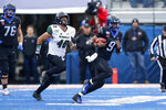 Boise State quarterback Jaylon Henderson, right, scrambles away from Hawaii defensive lineman Derek Thomas, left, during the first half of an NCAA college football game for the Mountain West Championship Saturday, Dec. 7, 2019, in Boise, Idaho. (AP Photo/Steve Conner)