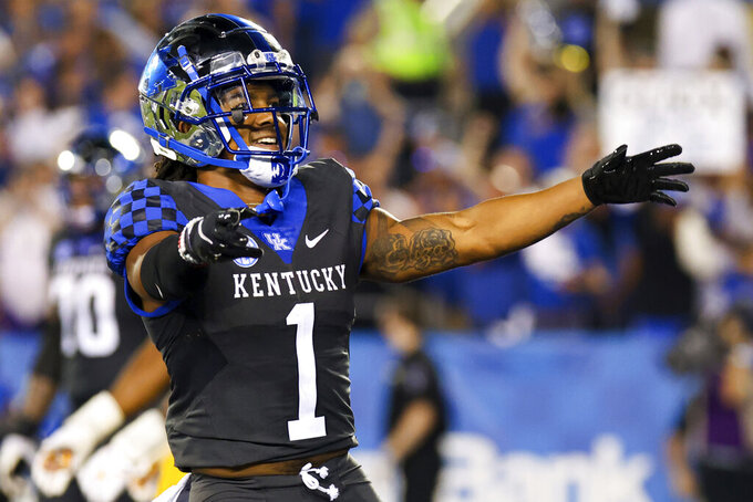 Kentucky wide receiver Wan'Dale Robinson celebrates his touchdown during the first half of an NCAA college football game against LSU in Lexington, Ky., Saturday, Oct. 9, 2021. (AP Photo/Michael Clubb)