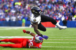 Baltimore Ravens running back Gus Edwards (35) is upend by Buffalo Bills cornerback Kevin Johnson (29) during the second half of an NFL football game in Orchard Park, N.Y., Sunday, Dec. 8, 2019. (AP Photo/Adrian Kraus)