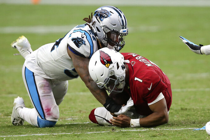 Arizona Cardinals quarterback Kyler Murray (1) is hit by Carolina Panthers outside linebacker Shaq Thompson during the second half of an NFL football game, Sunday, Sept. 22, 2019, in Glendale, Ariz. (AP Photo/Ross D. Franklin)
