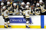 Boston Bruins' Torey Krug (47) is congratulated after scoring a goal against the San Jose Sharks in the first period of an NHL hockey game Monday, Feb. 18, 2019, in San Jose, Calif. (AP Photo/Ben Margot)