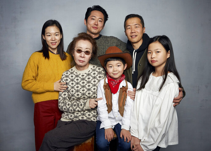 Han Yeri, from top left, Steven Yeun, director Lee Isaac Chung, Yuh Jung Youn, from bottom left, Alan Kim, and Noel Cho pose for a portrait to promote the film