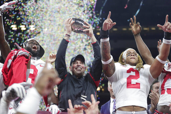 Ohio State coach Ryan Day celebrates after Ohio State defeated Wisconsin in the Big Ten championship NCAA college football game, early Sunday, Dec. 8, 2019, in Indianapolis. Ohio State won 34-21. (AP Photo/Michael Conroy)