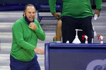 Notre Dame head coach Mike Brey yells to his players during the first half of an NCAA college basketball game against Duke on Wednesday, Dec. 16, 2020, in South Bend, Ind. Duke won 75-65. (AP Photo/Robert Franklin)