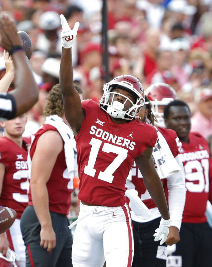 Oklahoma wide receiver Marvin Mims (17) celebrates a run for a first down against Western Carolina during the first half of an NCAA college football game Saturday, Sept. 11, 2021, in Norman, Okla. (AP Photo/Alonzo Adams)
