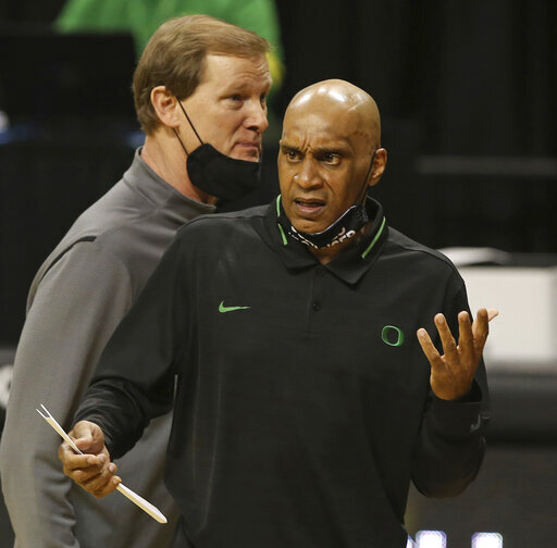 Oregon assistant basketball coach Tony Stubblefield, right, with head coach Dana Altman, left, questions a call during an NCAA college basketball game against Colorado on Feb. 18, 2021. DePaul has hired longtime Oregon assistan Stubblefield as head coach, hoping he can restore a struggling program, a person familiar with the situation told The Associated Press on Thursday, April 1, 2021. (Chris Pietsch/The Register-Guard via AP)