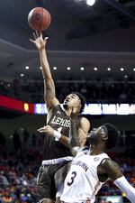 Lehigh forward Jeameril Wilson (1) shoots while defended by Auburn forward Danjel Purifoy (3) during the first half of an NCAA college basketball game Saturday, Dec. 21, 2019, in Auburn, Ala. (AP Photo/Julie Bennett)