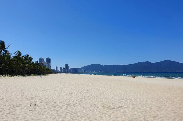 The once crowded beach is empty following a lockdown order in Da Nang, Vietnam, on Tuesday, July 28, 2020. Vietnam on Tuesday locked down its third-largest city for two weeks after more than a dozen cases of COVID-19 were found in a hospital. (AP Photo/Luke Groves)
