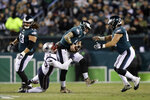 New England Patriots' Kyle Van Noy (53) tackles Philadelphia Eagles' Carson Wentz (11) during the first half of an NFL football game, Sunday, Nov. 17, 2019, in Philadelphia. (AP Photo/Matt Rourke)