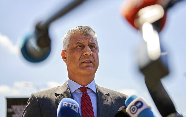 "Kosovo's president Hashim Thaci speaks to the media as he arrives at the Kosovo Specialist Chambers in The Hague, Monday July 13, 2020. Kosovo's president visited prosecutors at The Hague who have charged him with criminal responsibility for crimes including nearly 100 murders during and after his nation's battle for independence from Serbia, saying his visit was ""the price for freedom"" for his country. (AP Photo/Phil Nijhuis)"