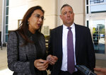 Attorneys Harmeet Dhillon, left , and Justin Clark who represented the state and national Republican parties, discuss the tentative ruling by a federal judge to halt a California law that's aimed at forcing the president to release his tax returns, in Sacramento, Calif., Thursday, Sept. 19, 2019. U.S.District Judge Morrison England Jr., said the will issue a formal ruling by Oct. 1. (AP Photo/Rich Pedroncelli)