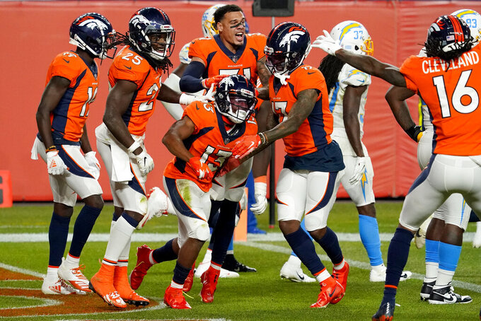 Denver Broncos wide receiver K.J. Hamler (13) celebrates his game-tying touchdown with teammates during the second half of an NFL football game against the Los Angeles Chargers, Sunday, Nov. 1, 2020, in Denver. The Broncos won 31-30. (AP Photo/Jack Dempsey)