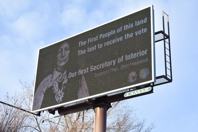 This Feb. 21, 2021, photo shows a billboard in Billings, Montana, displays support for New Mexico U.S. Rep. Deb Haaland, who has been nominated to lead the U.S. Department of the Interior. Native Americans will be watching her confirmation hearing closely on Tuesday, Feb. 23, 2021. If confirmed, she would be the first Native American to lead the agency that has broad oversight over tribal affairs and energy development.  (AP Photo/Matt Brown)