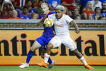 FILE - In this Sept. 18, 2019, file photo, Atlanta United forward Josef Martinez (7) and FC Cincinnati defender Andrew Gutman (96) vie for the ball in the first half of an MLS soccer match, in Cincinnati. Atlanta United, the defending MLS Cup champions, are heading into the playoffs from essentially the same position as last season.(AP Photo/John Minchillo, File)