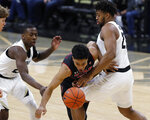 Utah guard Sedrick Barefield, center, is fouled by Colorado forward Evan Battey, right, while driving the lane past guard McKinley Wright IV during the first half of an NCAA college basketball game Saturday, March 2, 2019, in Boulder, Colo. (AP Photo/David Zalubowski)