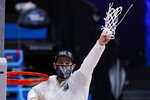 Baylor head coach Scott Drew holds up net after beating Arkansas during an Elite 8 game in the NCAA men's college basketball tournament at Lucas Oil Stadium, Tuesday, March 30, 2021, in Indianapolis. Baylor won 81-72. (AP Photo/Michael Conroy)