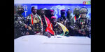 CAPTION CORRECTS SPELLING - In this image made from video, Col. Mamady Doumbouya, center, commander of the army's special forces unit, surrounded by others and draped in a Guinean flag, makes an address to the nation from state television headquarters in the capital Conakry, Guinea Sunday, Sept. 5, 2021. Mutinous soldiers in the West African nation detained President Alpha Conde on Sunday after hours of heavy gunfire rang out near the presidential palace in the capital, then announced on state television that the government had been dissolved in an apparent coup d'etat. (Radio Television Guineenne via AP)