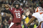 FILE - In this Nov. 25, 2017, file photo, South Carolina quarterback Jake Bentley (19) attempts a pass against Clemson during the first half of an NCAA college football game, in Columbia, S.C. South Carolina's Will Muschamp believes he's got the strongest, deepest and most talented team in his four seasons as the Gamecocks' coach.  (AP Photo/Sean Rayford, File)