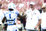 Mississippi State head coach Joe Moorhead greets Kentucky wide receiver Lynn Bowden Jr. (1) during warmups prior to an NCAA college football game, Saturday, Sept. 21, 2019, in Starkville, Miss. (AP Photo/Kelly Donoho)
