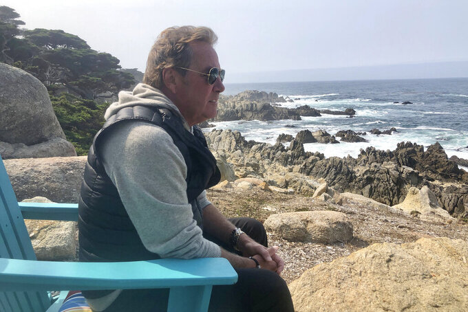 Jack Grandcolas, who lost his pregnant wife on United Flight 93, looks out at the ocean near his home in Pebble Beach, Calif., Aug. 18, 2021. Twenty years later, Grandcolas still remembers waking up at 7:03 that morning. He looked at the clock, then out the window where an image in the sky caught his eye — a fleeting vision that looked like an angel ascending. He didn't know it yet, but that was the moment his life changed. (AP Photo/Haven Daley)