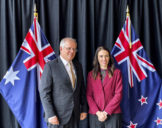 Australian Prime Minister Scott Morrison, left, poses for a photo with New Zealand Prime Minister Jacinda Ardern prior to talks in Queenstown, New Zealand, Monday, May 31, 2021. (Derek Cheng/NZ Herald via AP)