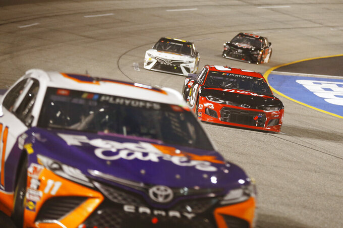 Austin Dillon, right, gives chase to race leader Denny Hamlin, foreground during a NASCAR Cup Series auto race Saturday, Sept. 12, 2020, in Richmond, Va. (James Wallace/Richmond Times-Dispatch via AP)
