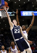 Butler forward Sean McDermott, left, drives to the basket against DePaul forward Paul Reed during the first half of an NCAA college basketball game Wednesday, Jan. 16, 2019, in Chicago. (AP Photo/Nam Y. Huh)