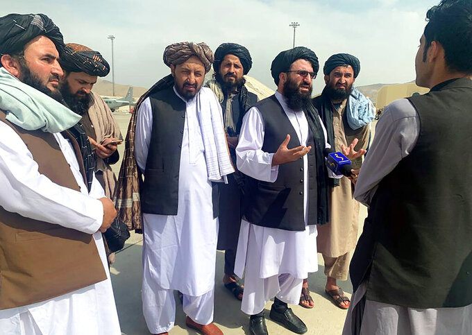 Taliban officials are interviewed by journalists inside the Hamid Karzai International Airport after the U.S. withdrawal in Kabul, Afghanistan, Tuesday, Aug. 31, 2021. The Taliban were in full control of Kabul's international airport on Tuesday, after the last U.S. plane left its runway, marking the end of America's longest war. (AP Photo/Kathy Gannon)
