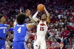 Arkansas guard Mason Jones (15) pulls up to shoot over Kentucky defenders Nick Richards (4) and Ashton Hagans (0) during the first half of an NCAA college basketball game, Saturday, Jan. 18, 2020, in Fayetteville, Ark. (AP Photo/Michael Woods)