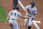 New York Yankees' Giancarlo Stanton, right, and third base coach Carlos Mendoza celebrate Stanton's three-run home run off Minnesota Twins' pitcher J.A. Happ during the first inning of a baseball game Thursday, June 10, 2021, in Minneapolis. (AP Photo/Jim Mone)