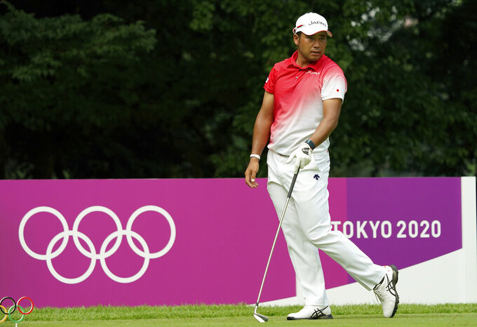 Japan's Hideki Matsuyama watches his tee shot on the fourth hole during the first round of the men's golf event at the 2020 Summer Olympics on Wednesday, July 28, 2021, at the Kasumigaseki Country Club in Kawagoe, Japan. (AP Photo/Matt York)